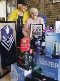 Jan Crow and her mum Hilary Muirson with auction items. Picture: Martin Kennealey d403458