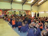 Indigenous performer Lucas Proudfoot plays to Arbor Grove Primary School