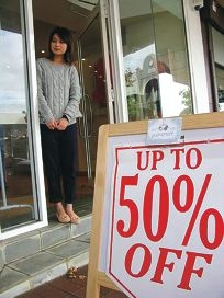 Yuevenism co-owner Yumi Goh outside the store, which is up for lease just eight months after it opened.