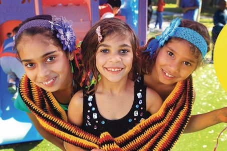 Sisters Katherine (11), Alicia (6) and Leonie Bynder (8) celebrate. Picture: Marcelo Palacios www.communitypix.com.au d403685