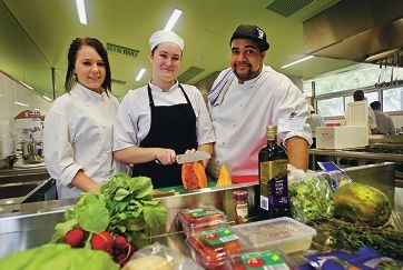 Michelle Mills (17) of Cloverdale, Filicity Southern-Timms (17) of Redcliffe and Chef Lloyd Hayes.  Belmont City College are taking part in a Foodbank campaign called Prepare, Produce, Provide and involves students from 12 schools across WA producing 5000 meals that will be provided to those in need in the community.
