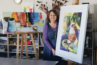 Artist and teacher Karen Frankel with two of her works. Picture: Marcus Whisson