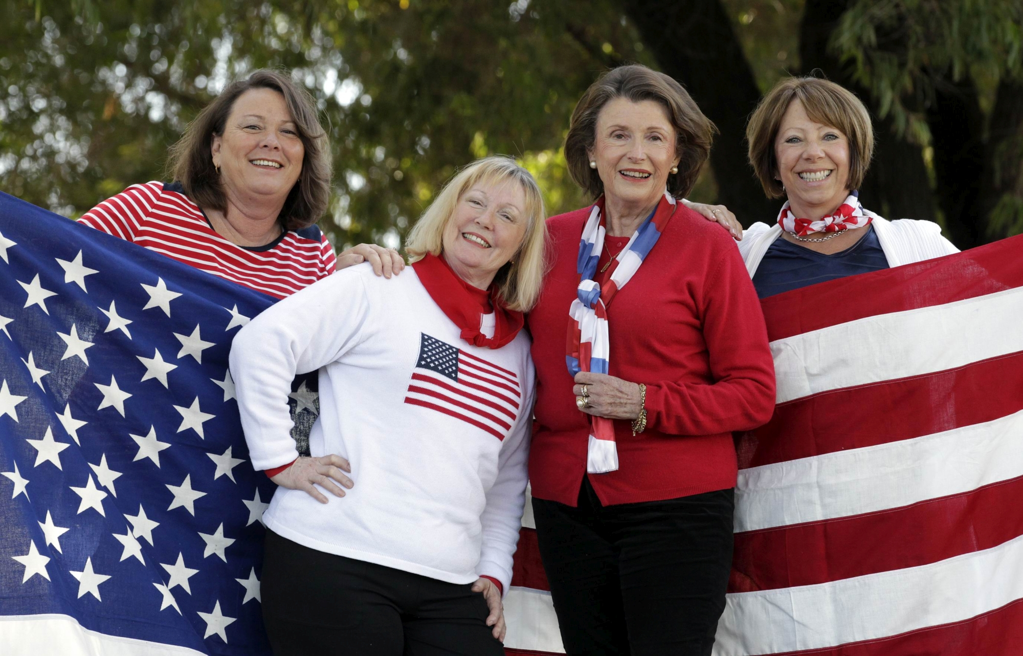 American Women's Club of Perth members Denise Mosley, Gail Campbell, Rhonda Metka and Cheryl Rosenthal fly the flag to celebrate the American Independence Day. Picture: Martin Kennealey www.communitypix.com.au d404042