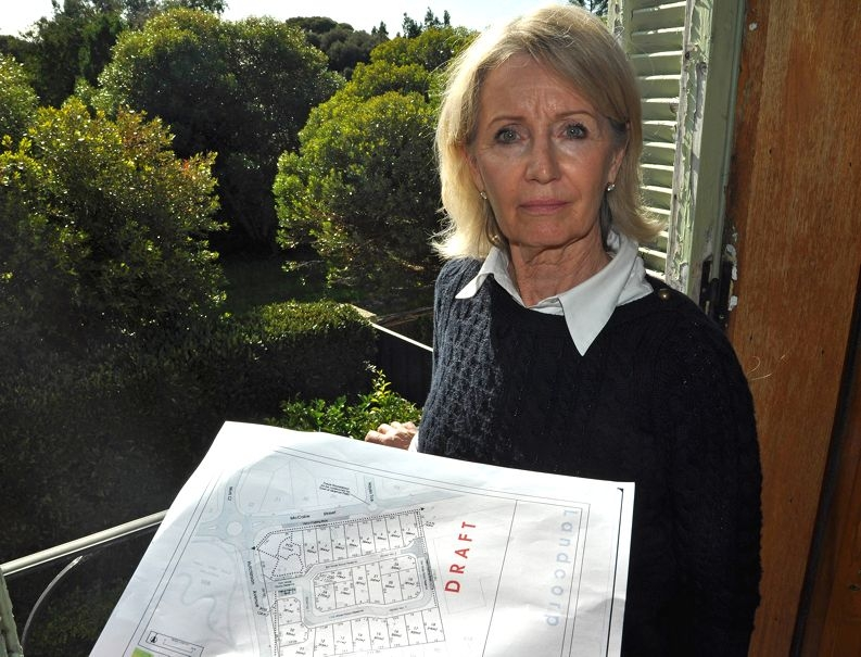 LandCorp's draft plan may have homes built near Jenna Ledgerwood's fence line.