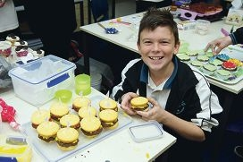 Tapping PS Year 7 student Sam Hannon decorates cupcakes to sell to raise money for cancer research. Picture: Emma Reeves www.communitypix.com.au d403756
