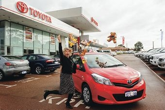 Centro Warwick Big Rock Toyota competition winner Margaret Hahnel from Bayswater with her shiny new red Toyota Yaris.