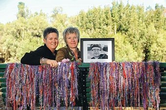 Alison and Michelle sit on the Hyde Park bench they donated in their daughter Evie's honour. Picture: Marcus Whisson www.communitypix.com.au d403631