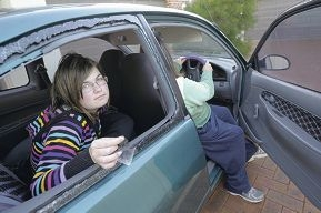 Cody (14) and Linda in the damaged car.