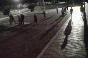 Mean streets: A gang of youths walk along Morrison Road in Midland at 8.45pm on a Saturday night.