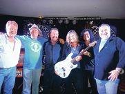 Paul Fitton, co-founder Derek Cromb, Chris Blackwell, guitar winner Shazza Fuller, Jim Awram and co-founder Dave Gillam. Right: Warren and Vonda Pater.