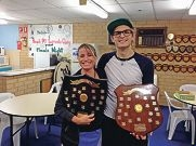 Winners: Sam Brown with women's club champion Linda Towill.