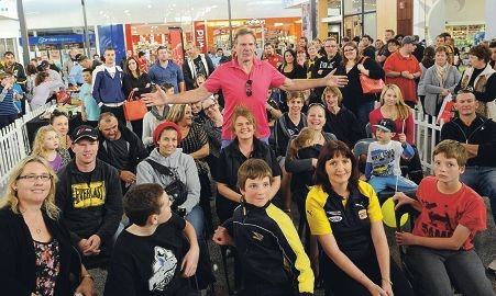 Sam Newman surrounded by fans at The Shops in Ellenbrook.