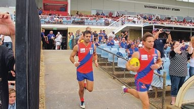 West Perth's Marc Crisp (front) with Anthony Tsalikis run out for a game.