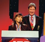 Cate and Peter Brodie receiving the top retailer award in Chicago.