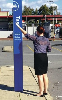 Shannon Lumsden waits for a taxi in Midland.