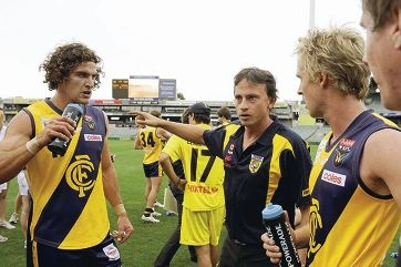 Coach Marc Webb (centre) instructing WA players.