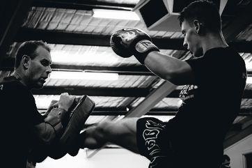 Main picture: Murray McKechnie prepared Joel Arasi for Saturday night's Muay Thai clash.