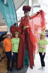Telstra staff with the stilt walker.