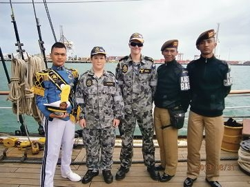 Leading Seaman Declan Smith (centre) and Seaman Moore from TS Navy Cadet Unit with Indonesian Navy Cadets.