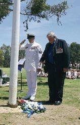 Petty officer Adam Bamford and Vietnam veteran Geof Irwin lay a wreath.