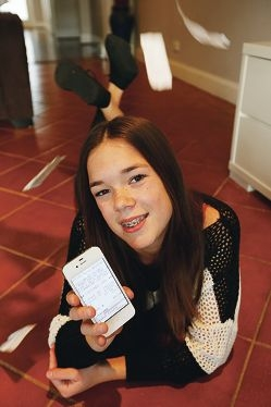 Teenager Sophie Ebert shows the cash receipt app she designed for use with mobile phones. Picture: Andrew Ritchie d423071
