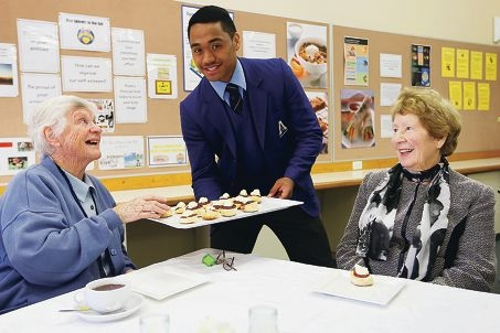 Try one of these... Sister Catherine O'Connor and Florence Moscarda being offered a tasty treat by Aranmore Catholic College Year 11 student Corry Tearoa. Picture: Andrew Ritchie