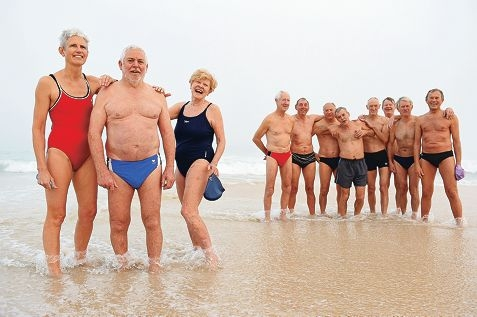 From left: Lee Doak, Stephen Knott and Diana Warnock with fellow early morning City Beach swimmers in the background.