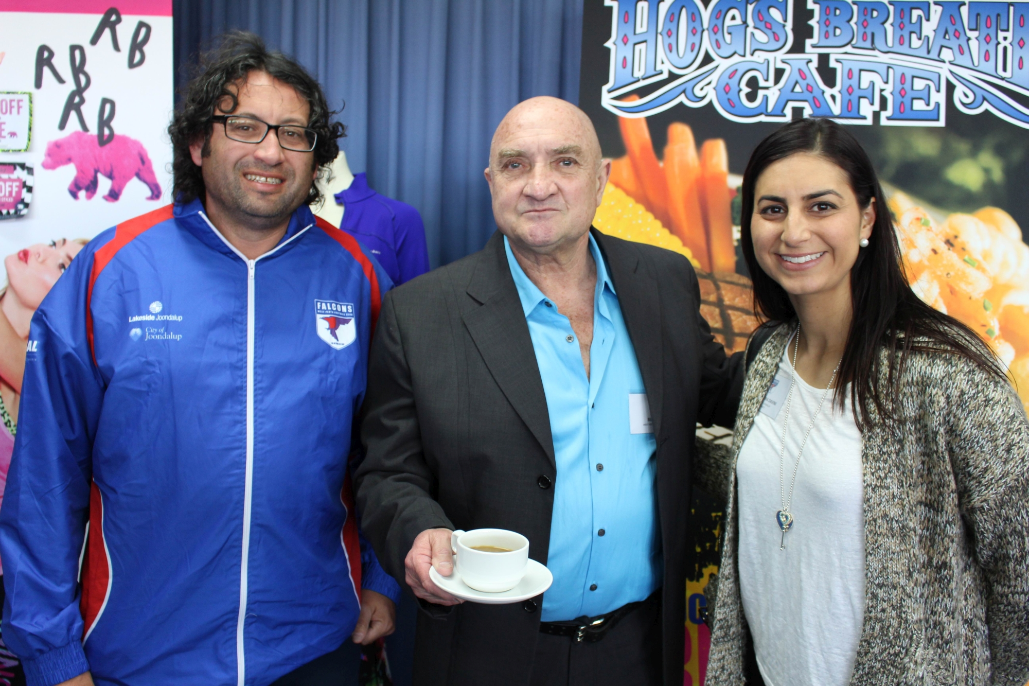 Former West Perth player and Team of the Century member Bill Valli flanked by club director Richard Homsany and Falcons supporter Christina Davini.