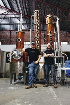 Al Malloch and Jimmy McKeown stand proudly in front of their first copper still.