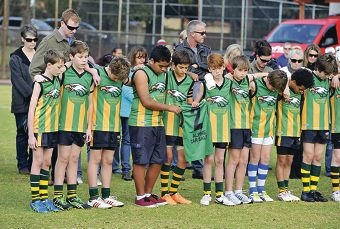 Teammates of Mo Maslin unite in his memory at a football match on Sunday. Picture: Justin Benson-Cooper