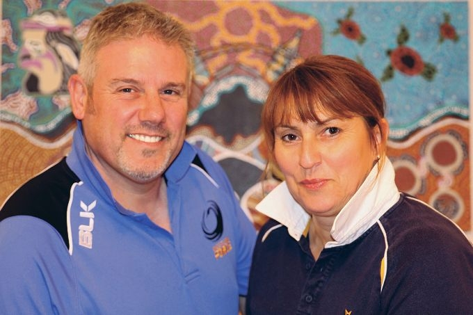 Mark and Mandy Morgan-Jones in their Western Force and Waratah jumpers. Picture: Justin Bianchini
