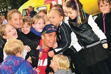 Ky Hurst is mobbed by students from Bungaree Primary School during his fly-in visit last Friday