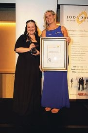 Bianca Chater receives her best business award from the Commonwealth Bank's Rhiannon Bloffwitch.