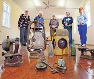 Bullsbrook Residents and Ratepayers Association members Lylia Richards, Judith Beer, Ethel Warren, Val Pate and Kathy Crofts with some of the historical artifacts. d421306a