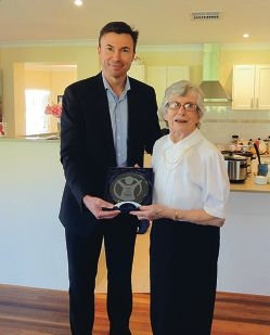Save the Children CEO Paul Ronalds presents Johanna Bowen with her life membership.