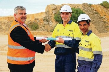 Mindarie Regional Council's Gunther Hoppe receives the plans from trainees Mitchell Robb and Landon Punch.