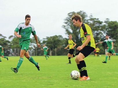 Captain Kye Middleton manouvres the ball for Curtin University.