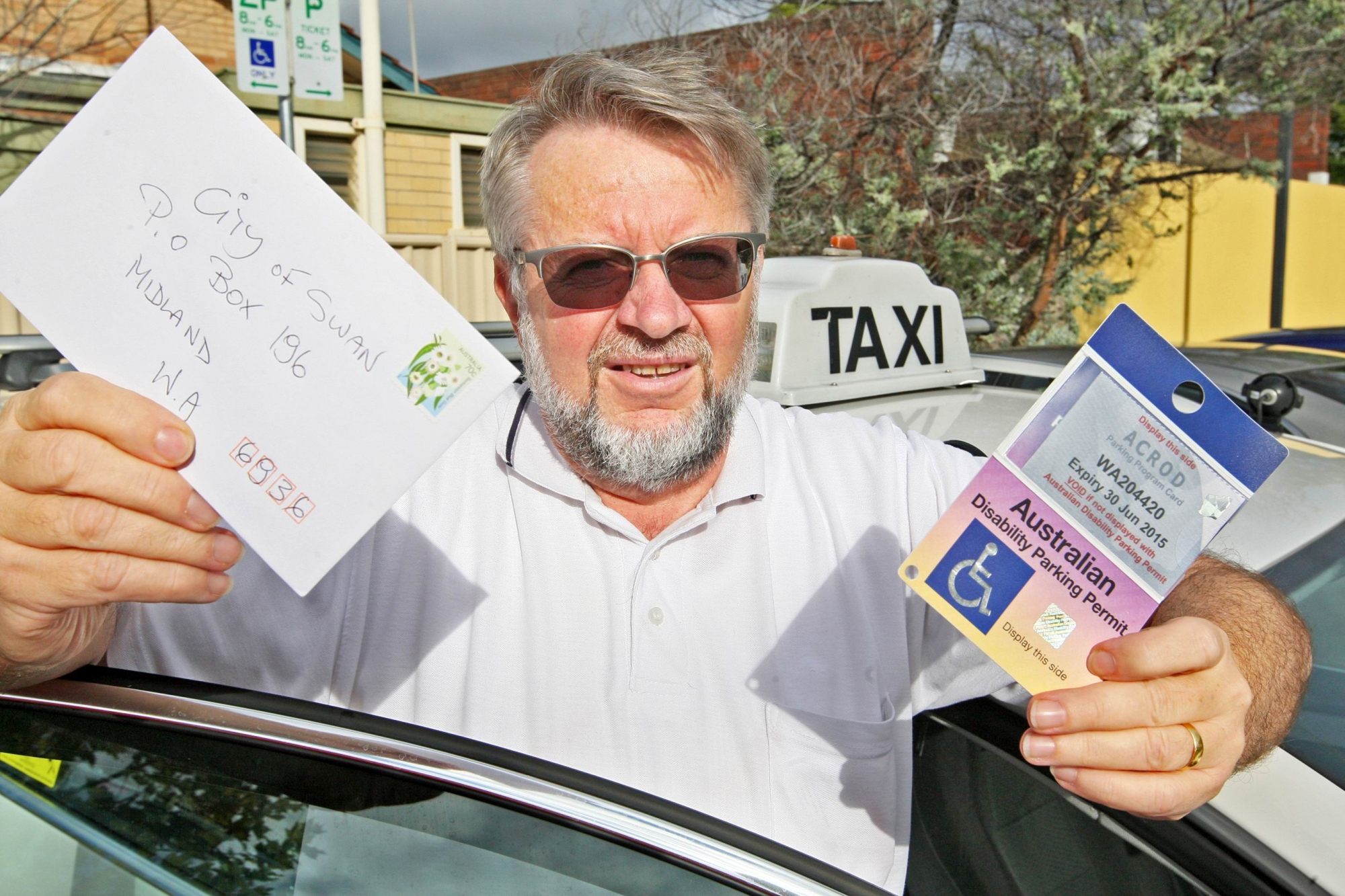 Mr Kuligowski with his disabled parking sticker. He received a fine for the five minutes he took to accompany a disabled woman to the Centrelink office in the rain, to prevent her from falling over.