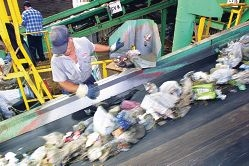 Workers at the Mirrabooka Atlas Recycling facility sort the City of Stirling's waste.