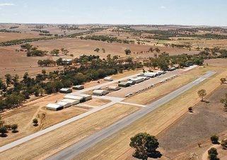 Hangars lined up along the tarmac at Northam Airfield.