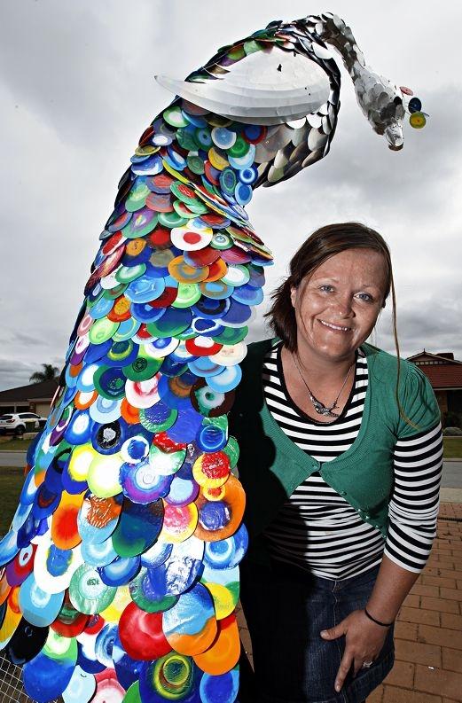 Jacq Chorlton with her peacock sculpture. Picture: Elle Borgward www.communitypix.com.au d419368