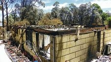The remains of one of 55 homes destroyed by fire earlier this year in Stoneville.