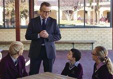 New principal targets the next millenium