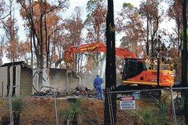 A fire-damaged house on Kalari Way, Stoneville, was demolished last week.