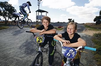 BMX racers Kyle (14) and Kira (9) Hill.