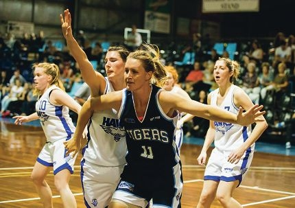 Willetton Tigers centre Emma Lobb in action against the Perry Lakes Hawks on Saturday night. Picture: Vic Wong