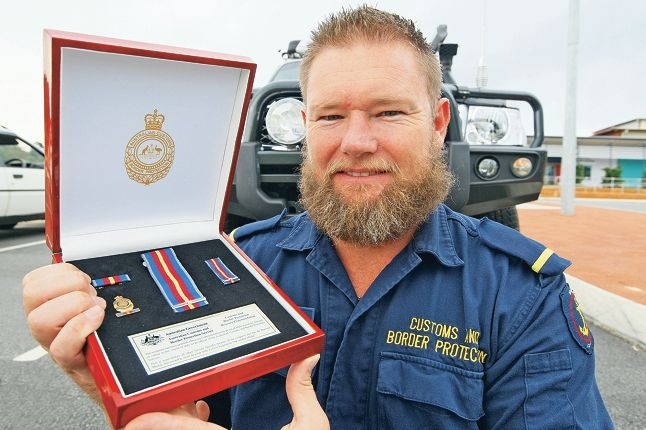 Michael Burgess received an Australian Bravery Decoration for helping to save the lives of 42 asylum seekers off Christmas Island in 2010. Picture: Bruce Hunt www.communitypix.com.au d418198
