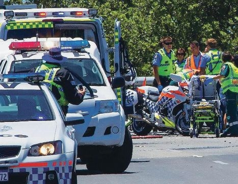A woman died and two others suffered life-threatening injuries in a crash on the Brand Highway yesterday.