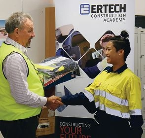 Year 12 student Ricci-Rose McAlister receives her Academy uniform from Ertech chairman Jim Giumelli.