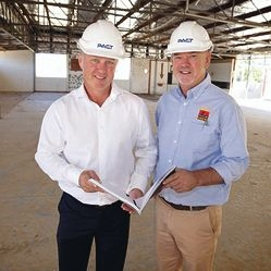 Pact Construction general manager Jason Kunkler and Clontarf Foundation chief executive Gerard Neesham look over the redevelopment plans.